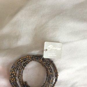 Beaded metallic in color bracelet.